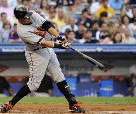 Orioles first baseman Kevin Millar connects for a three-run homer in the second inning of a 13-4 victory over the Yankees.