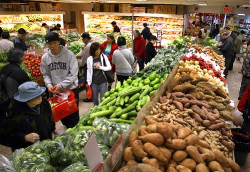 Shoppers at C Market on Washington Street.
