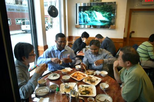 A group of men have lunch at the Gourmet Dumpling House on Beach Street.