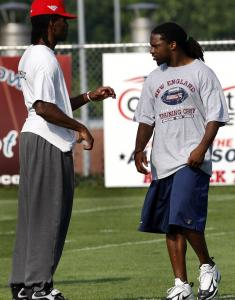 Patriots receiver Randy Moss (left) has a little chat with second-year safety Brandon Meriweather. It's been Meriweather, however, who has been doing a lot of talking at camp.