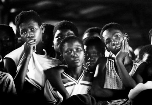Friends mourn during 1985 funeral service in Leandra of Chief Ampie Mayisa, who was killed in a revenge attact.