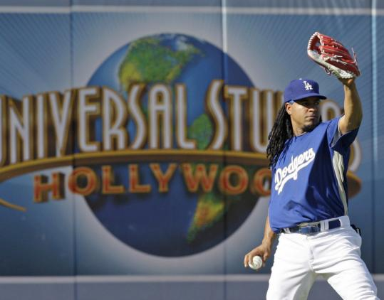 There's no question Manny Ramírez has gone Hollywood. Warming up in front of the Universal Studios sign in the outfield, the newest Dodger prepared for his debut with Los Angeles.