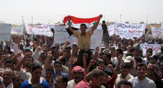 Protesters in the town of Hawija, west of Kirkuk, carried banners rejecting Kurdish demands for control of Kirkuk.