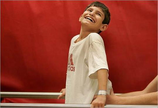 Rakan Hassan flashed his famous smile during a physical therapy session in Boston in November 2005.
