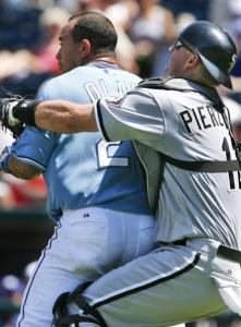 Chicago's A.J. Pierzynski restrains enraged Miguel Olivo before he reaches pitcher D.J. Carrasco