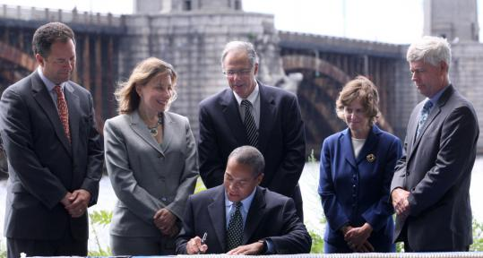 Governor Deval Patrick signed the $3 billion bridge bond bill yesterday. With him were (from left) Ian Bowles, state energy and environmental affairs secretary; Representative Lori Ehrlich, a Marblehead Democrat; Bernard Cohen, transportation secretary; Luisa Paiewonsky, state highway commissioner; and Richard Sullivan, state conservation and recreation commissioner.