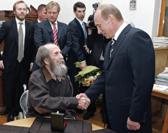 Vladimir Putin (right) visited Alexander Solzhenitsyn (center) last year in the outskirts of Moscow. For the former dissident, who returned to Russia in 1994, Putin was the country's savior.
