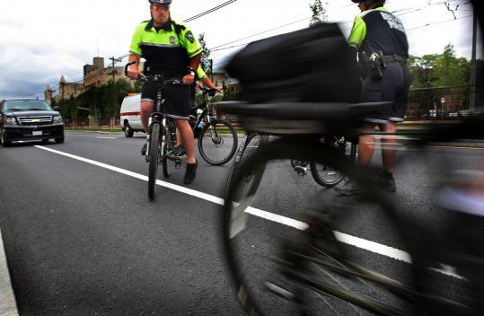 Police officers from the Citywide Bike Unit took off yesterday on a stretch of the new bike lane on Commonwealth Avenue after Mayor Thomas M. Menino updated cyclists on progress in making the city more compatible for bikes.