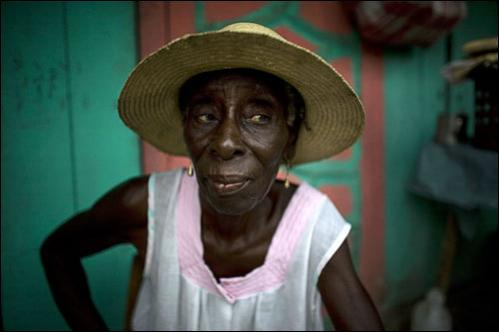 Street vendor Adrilia Antoine, 70, poses for a photo at her home in Jacmel, Haiti, Saturday, July 12, 2008.