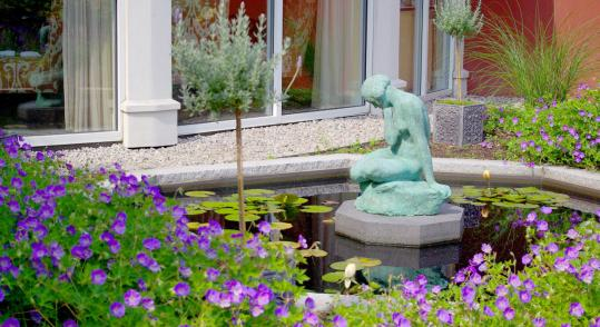 The fountain courtyard at the Portland Harbor Hotel was preserved during renovations and is a lush oasis of calm.