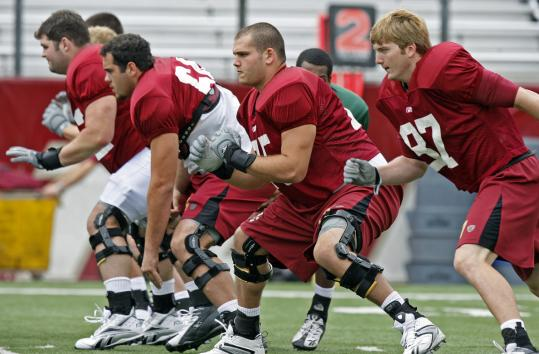 Boston College offensive lineman Nathan Richman (center) during an Eagles workout.