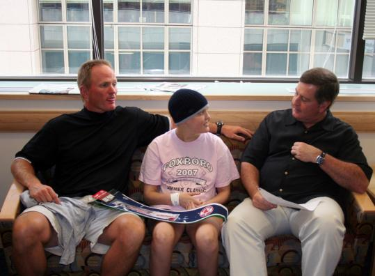 WEEI morning show cohosts Gerry Callahan (left) and John Dennis flank Jimmy Fund Clinic patient Caroline Miller, 13, during a recent visit to the Dana-Farber Cancer Institute. The annual Jimmy Fund Radio-Telethon is next week.