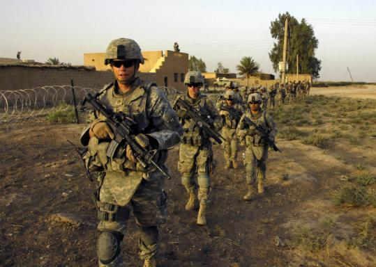 US Army soldiers in Diyala province last month. Two Iraqi officials say the United States and Iraq are close to a deal under which all American combat troops would leave by October 2010.