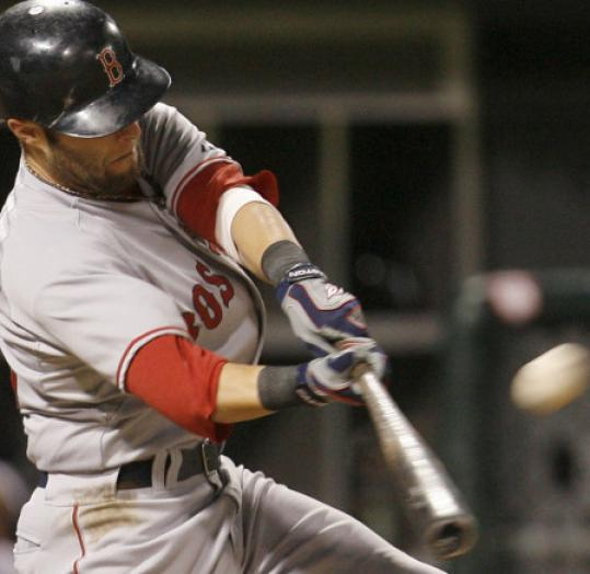 Dustin Pedroia extended his road hitting streak to 27 games with a three-run home run in the eighth.