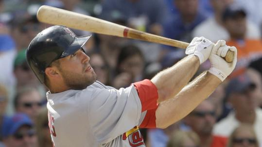 The Cardinals' Troy Glaus launches a three-run home run in the sixth inning vs. the Cubs. He had two of St. Louis's four homers off Carlos Zambrano.