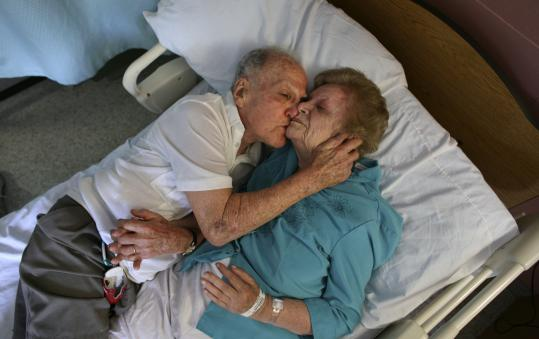 Sol Rogers cuddled up with his wife, Rita, during a recent afternoon at Briarwood Healthcare and Rehabilitation Center in Needham.