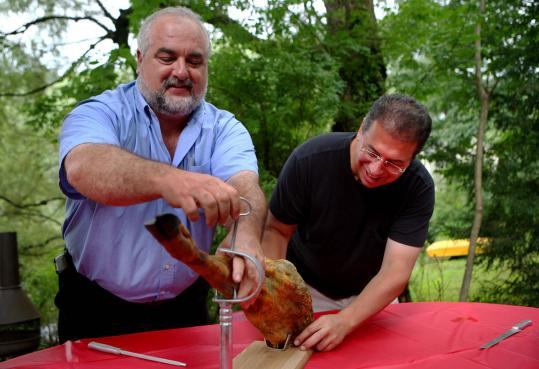 Victor Grillo (right, with Matthew Torti) put his name on a waiting list two years ago to get a jamon iberico. Now that Grillo's ham has arrived, he's throwing a party.