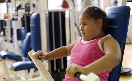 Taina Pena, 9, of the South End worked out on an exercise machine at Body by Brandy fitness studio in Boston.