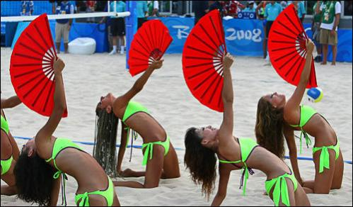 Cheerleaders perform during the women's and men's preliminaries of Beach Volleyball at Beijing's Chaoyang Park Beach volleyball ground, on August 9, 2008, the first day of the competitions for the 2008 Beijing Olympic Games.
