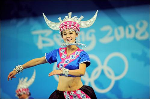 About 600 Chinese volunteers trained to perform during the games, cheering for teams in a variety of events regardless of which nation is playing. Chinese cheerleaders perform before the men's 69 kg weightlifting event during the 2008 Beijing Olympic Games at the Beijing University of Aeronautics and Astronautics Gymnasium in Beijing on August 12, 2008.