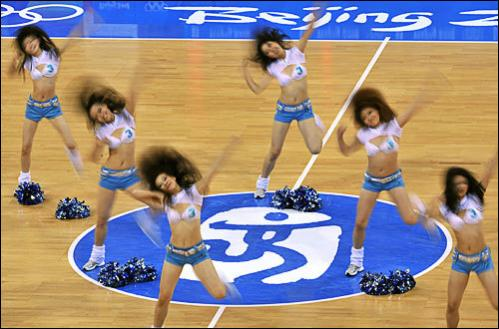 Beijing cheerleaders perform during a break in the action in the women's preliminary round group B basketball match between Spain and New Zealand at the Olympic basketball arena during the 2008 Beijing Olympic Games on August 11, 2008.