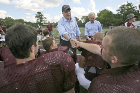 Senators John McCain and Joseph Lieberman met Manheim Central High's football team in Manheim, Pa., yesterday.