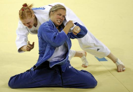 Ronda Rousey (front) battles Germany's Annett Boehm to win the bronze medal in judo's 70-kilogram class.