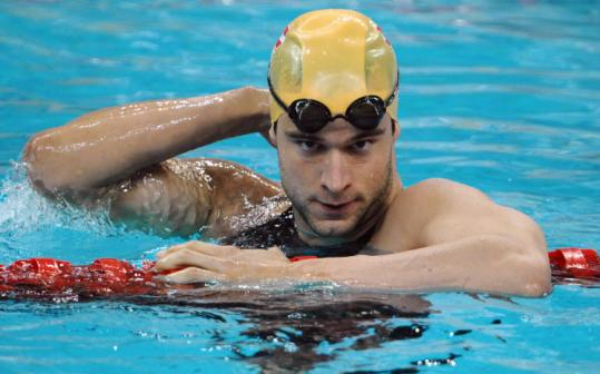 Markus Rogan won a pair of silver medals in Athens four years ago, yet he admits he ''really doesn't like swimming.''
