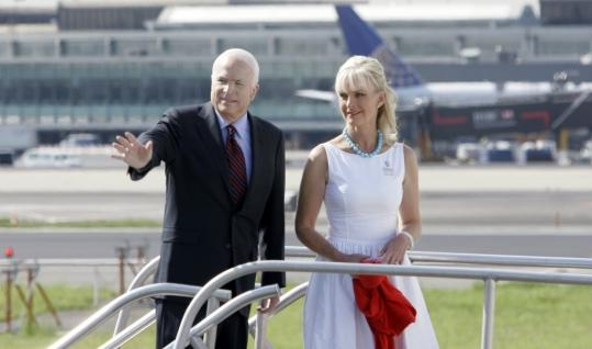 John McCain, with wife Cindy in New Jersey yesterday, has taken a harder line on Moscow than the Bush administration. An Obama aide suggested that may have ''complicated the situation.''