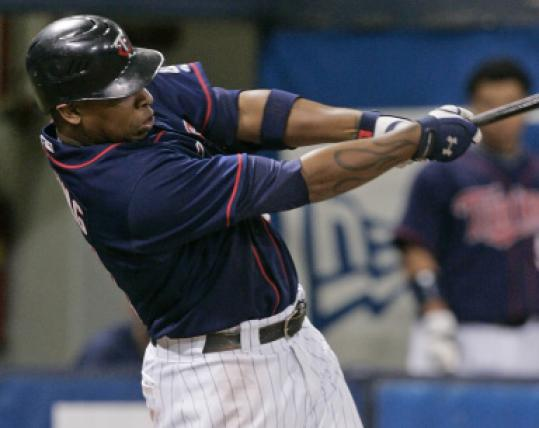 Delmon Young follows through on a three-run homer in the fourth to help sink the Yankees.