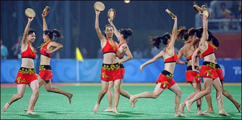 Cheerleaders perform during a break in a 2008 Beijing Olympic Games men's field hockey match between the Netherlands and Great Britain in Beijing on August 13, 2008. The Netherlands won 1-0.