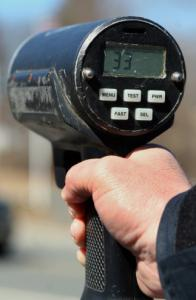 A police radar gun clocks a car at 33 miles per hour in a 25 mph zone in Medway. Angles can affect readings.