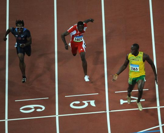 Usain Bolt (right) beat Richard Thompson (center) and American Walter Dix by a mile.