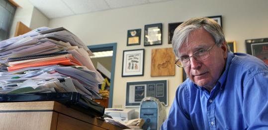 Thomas Kunz's office is cluttered with bat memorabilia.