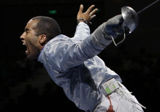 Touché! Keeth Smart, who came up short at Athens, theatrically celebrates after he rallied to beat his Russian counterpart and lead the US to silver.