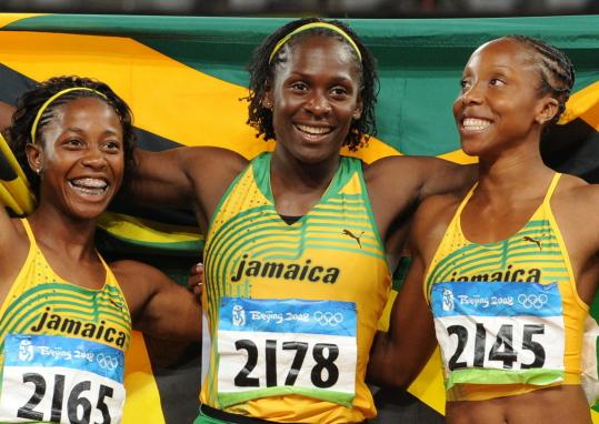Shelly-Ann Fraser (left), Kerron Stewart (center) and Sherone Simpson are on top of the world.