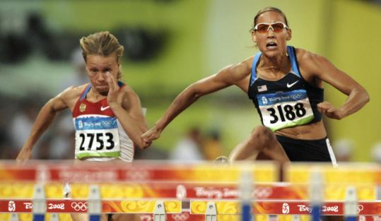 It was smooth sailing for Lolo Jones (right) in the first heat of the 100 hurdles, even though she wasn't completely satisfied.
