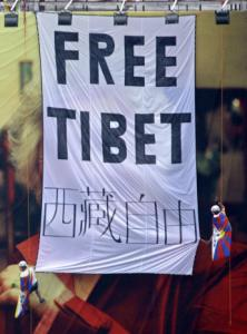 Oded Balilty/Associated PressActivists unfurled a ''Free Tibet'' banner and Tibetan flags Friday in Beijing on top of an Olympics billboard.