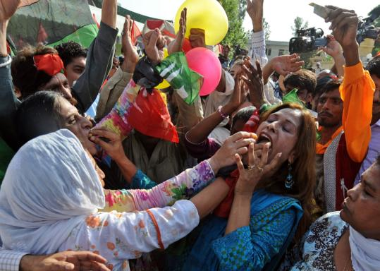 Activists of Pakistan People's Party shared sweets yesterday to celebrate the resignation of President Pervez Musharraf in Islamabad. His exit was announced in an emotional address.