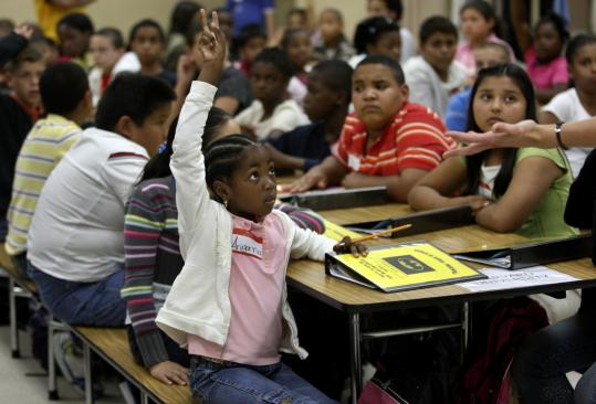 Fifth-grader Ariyanna Agnew offers to answer a question in math class at KIPP Academy Lynn on the third day of school.