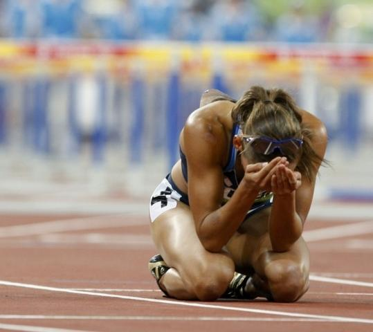 American Lolo Jones, a gold medal favorite in the hurdles, is alone in her anguish after she stumbled to seventh place.