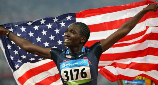 A happy Dawn Harper soars around the Bird's Nest after negotiating every hurdle in her path.