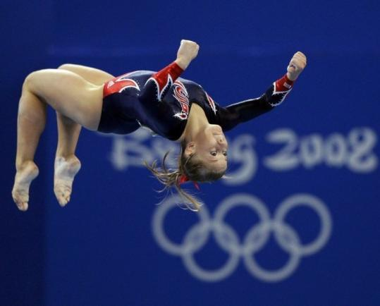 Shawn Johnson is up in the air here, but when her routine was done, she definitely had won the gold in the balance beam.