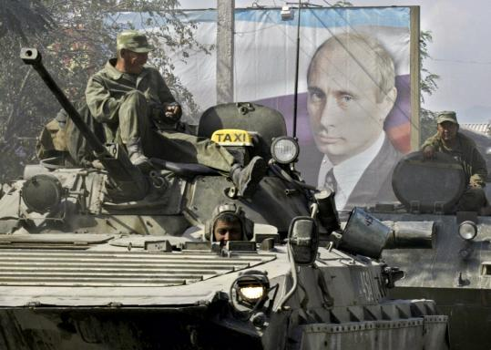 With a portrait of Prime Minister Vladimir Putin behind them, Russian soldiers took position in Tskhinvali, capital of Georgia's breakaway province of South Ossetia, yesterday.