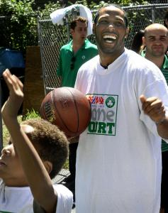 Celtic Eddie House on the Fignole family's new court yesterday in Randolph.