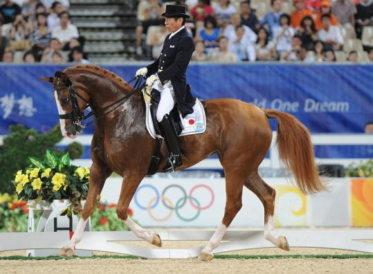 Forty-four years after his first Olympic experience, Hoketsu Hiroshi rode Whisper to a 35th-place finish in dressage.