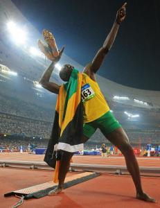 In his unique fashion, Jamaica's Usain Bolt celebrates becoming the first man since the legendary Carl Lewis in 1984 to win the 100- and 200-meter sprint double.