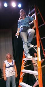 Winthrop High School students (from left) Lauren Amaru, Sarah Ford, and Melissa MacNeil adjust stagelights.