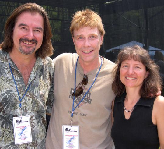 Marc Rines (left) and Karen Stanley (right), members of the local band Ashbrook Haynes, with WZLX DJ Carter Alan.