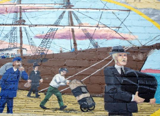 Detail from one of nine accounts of the immigrant experience that Chris Tauson painted a decade ago on an outside wall of the East Boston Neighborhood Medical Center's administrative building.
